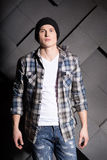 Handsome man in jeans, hat and shirt on grey background Stock Photo
