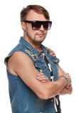 Handsome man in jeans vest and sunglasses posing, fashion man. over white Stock Image