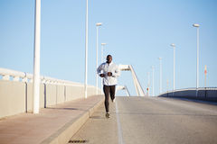 handsome man in jogging on the bridge Royalty Free Stock Image