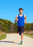 Handsome man jogging Royalty Free Stock Image