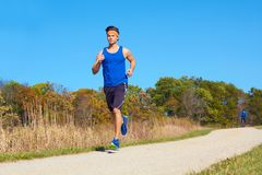 Handsome man jogging Stock Image