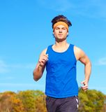 Handsome man jogging Stock Photos
