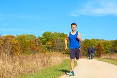 Handsome man jogging Royalty Free Stock Photos