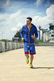 Handsome man jogging outdoors Royalty Free Stock Image