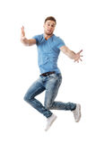 Handsome man jumping for joy. Royalty Free Stock Photos