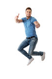 Handsome man jumping for joy. Cheerful handsome man jumping for joy Royalty Free Stock Images