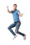 Handsome man jumping for joy. Stock Photos