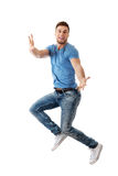 Handsome man jumping for joy. Royalty Free Stock Photo