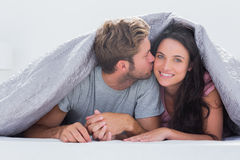 Handsome man kissing his wife Royalty Free Stock Image