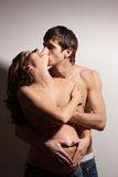 Handsome man kissing pregnant woman Royalty Free Stock Images