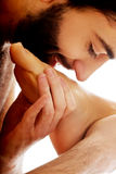 Handsome man kissing woman's foot. Stock Photos