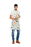 Handsome man with kitchen apron, isolated on white Stock Photography