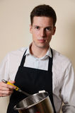 Handsome man in the kitchen Royalty Free Stock Photography