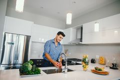Handsome man in a kitchen stock image