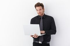 Handsome man with laptop stock photos
