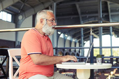 Handsome man with laptop in cafe Royalty Free Stock Photography