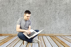Handsome man and laptop Stock Photography
