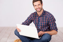 Handsome man with laptop. Royalty Free Stock Photography