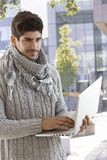 Handsome man with laptop in the city Royalty Free Stock Photo