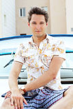 Handsome man with laptop sitting on white yacht Royalty Free Stock Photography