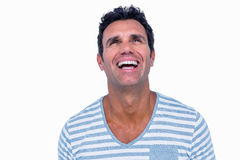 Handsome man laughing and looking away Stock Photos