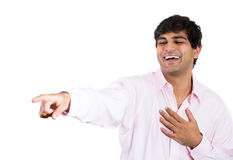 Handsome man laughing at someone or something Stock Images