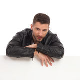 Handsome man lean on the blank banner Royalty Free Stock Photo
