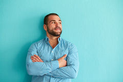 Handsome man leaning against wall Royalty Free Stock Image