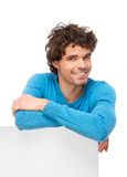 Handsome Man Leaning on Black Signboard Royalty Free Stock Photos