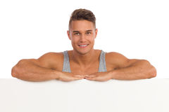 Handsome Man Leans On A Banner Stock Images