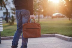 Handsome man with a leather bag in the city Royalty Free Stock Images