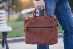 Handsome man with a leather bag in the city Royalty Free Stock Image