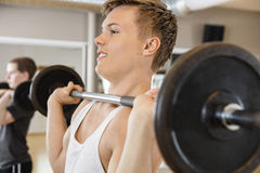 Handsome Man Lifting Barbell In Gym Royalty Free Stock Image
