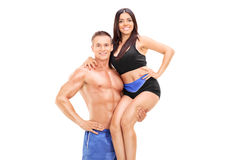 Handsome man lifting his girlfriend Royalty Free Stock Photos