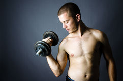 Handsome man lifting weights Stock Photo