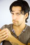Handsome man lighting cigarette Stock Photos