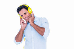 Handsome man listening music with headphone Stock Photo