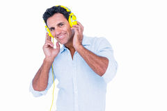 Handsome man listening music with headphone Royalty Free Stock Photo