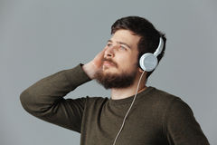 Handsome man listening music in headset Royalty Free Stock Photo