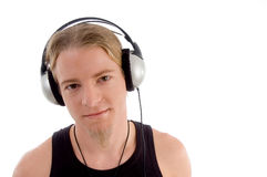Handsome man listening to music Stock Photography