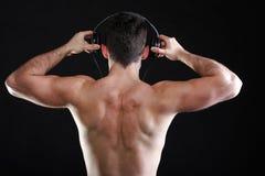 Handsome man listening to music on headphone Stock Photos