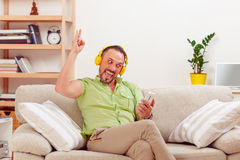 Handsome man listening to music at home Stock Image