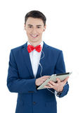 Handsome  man  listening to music from your tablet computer Stock Images