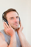 Handsome man listening to some music. Handsome man listening to music Stock Photography