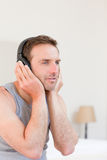 Handsome man listening to some music. And smilling Stock Photography