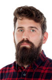 Handsome man with long beard wearing checkered shirt Stock Image
