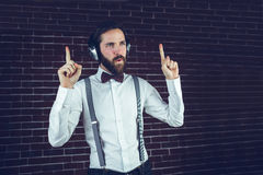 Handsome man looking away while listening music Royalty Free Stock Photography