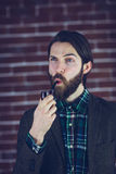 Handsome man looking away with smoking pipe Royalty Free Stock Photography