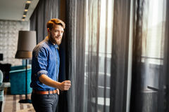 Handsome man looking at cityscape royalty free stock photo