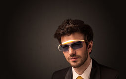 Handsome man looking with futuristic high tech glasses Royalty Free Stock Photography
